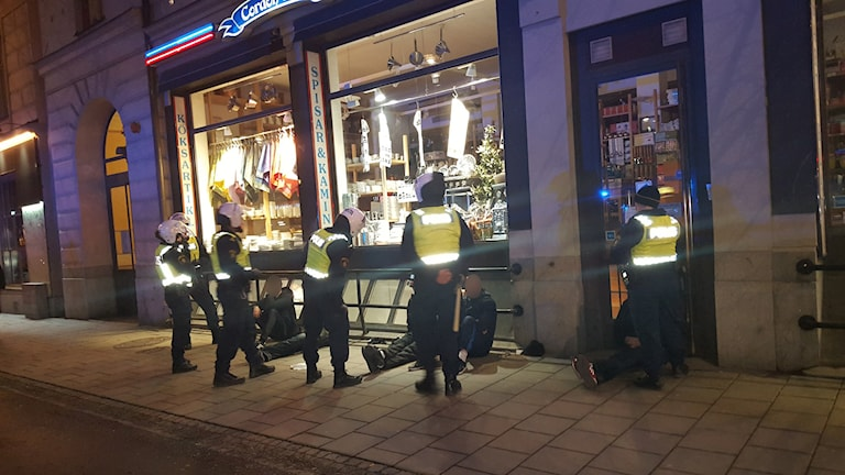 Police detaining suspects in downtown Stockholm Friday night. Photo: Swedish Radio.