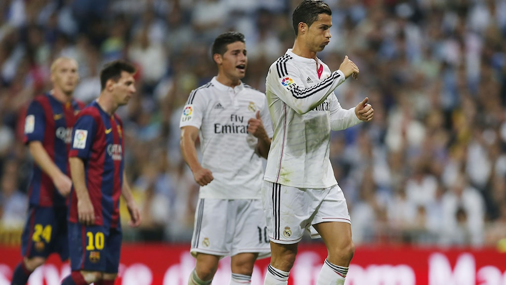 Real Madrid's Cristiano Ronaldo, right, gestures next to Barcelona's Lionel Messi, second left, during a Spanish La Liga soccer match between Real Madrid and FC Barcelona at the Santiago Bernabeu stadium in Madrid, Spain, Saturday, Oct. 25, 2014. AP Photo/Andres Kudacki