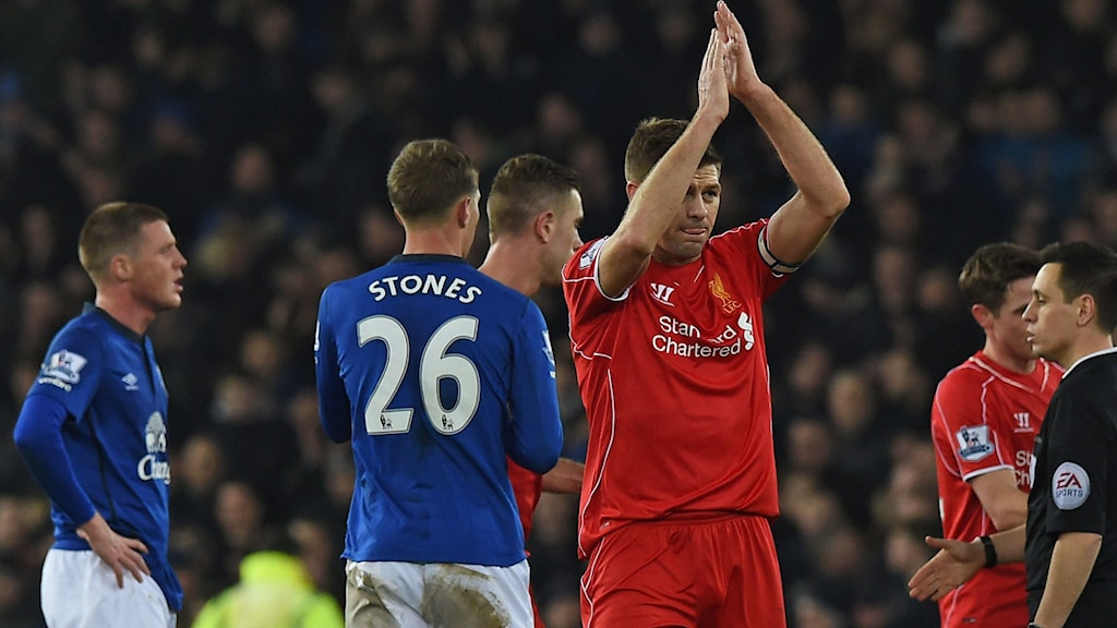 Liverpool's English midfielder Steven Gerrard applauds the supporters on the pitch after the English Premier League football match between Everton and Liverpool at Goodison Park in Liverpool on February 7, 2015. The game ended 0-0. AFP PHOTO / PAUL ELLIS