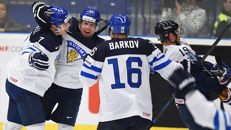 Finland's players celebrate their goal during the group B preliminary round match between Finland and Slovakia of the IIHF Ice Hockey World Championship at the CEZ Arena in Ostrava on May 9, 2015. AFP PHOTO / JOE KLAMAR