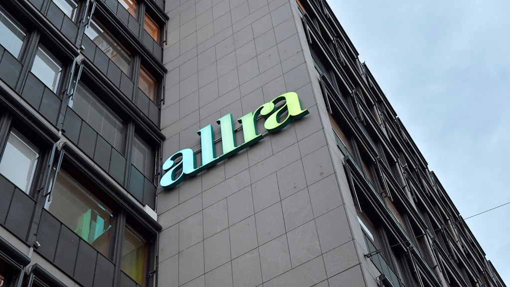 A building with a sign for the company Allra