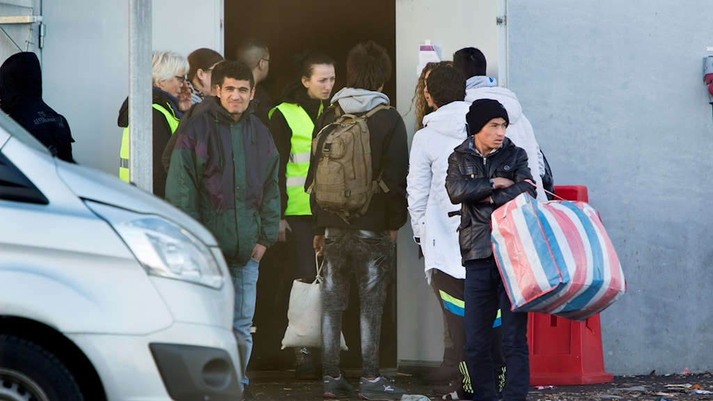 Asylum seekers arrive at temporary shelter at the Malmö Mässan conference centre.