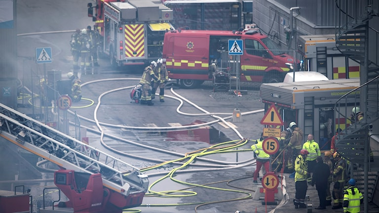Fire fighters outside a Volvo facility in Sörred, Sweden.