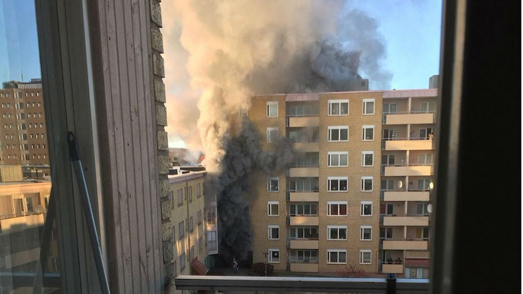 A picture taken at 13:24, soon after the fire began, shows how it wreathed the whole tower block in smoke. Photo: Asrin Qasim/Private