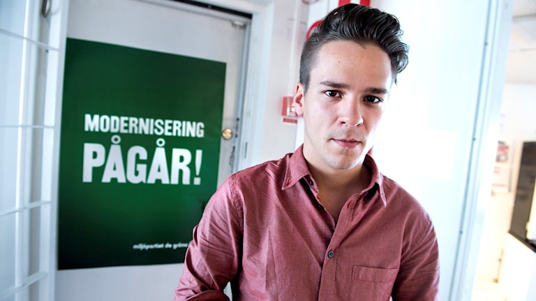 Lorentz Tovatt, spokesman for the Young Greens, infront of a campaign poster. File photo: Lars Pehrson / TT.