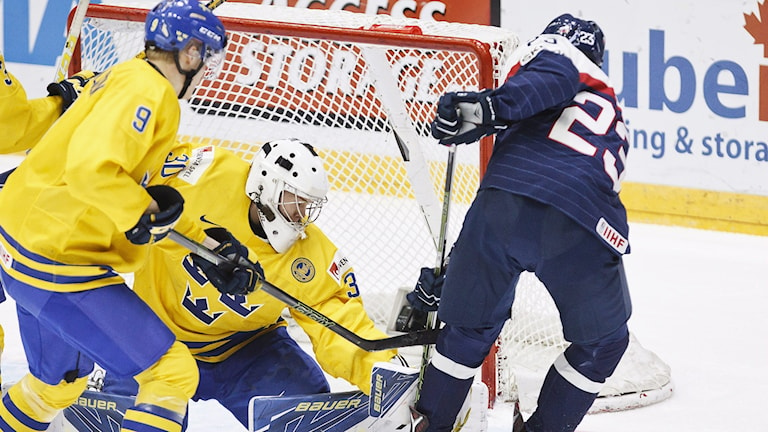 Sweden's Gabriel Carlsson, left, and goalkeeper Linus Soderstrom and Lukas Hrusik of Slovakia face off before the Swedish goal. Sweden won 6-0. Photo: Roni Rekomaa/Lehtikuva/TT Bild