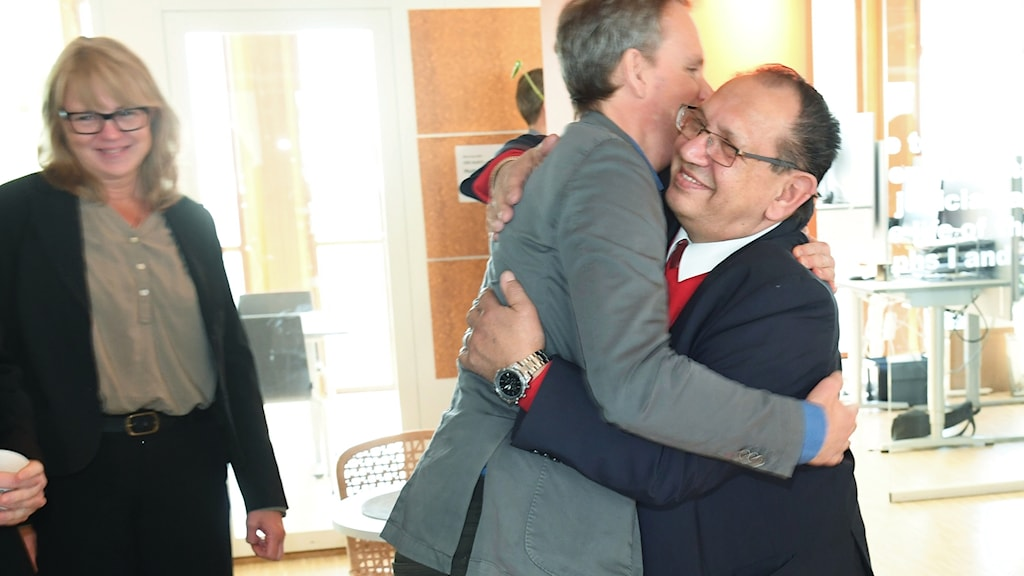 lawyer John Stauffer (right) hugs Roma plaintiff Fred Taikon after the ruling was announced.