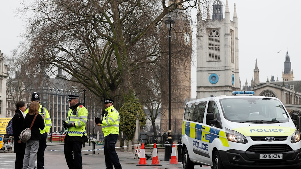 Police gathered outside of parliament building in London.
