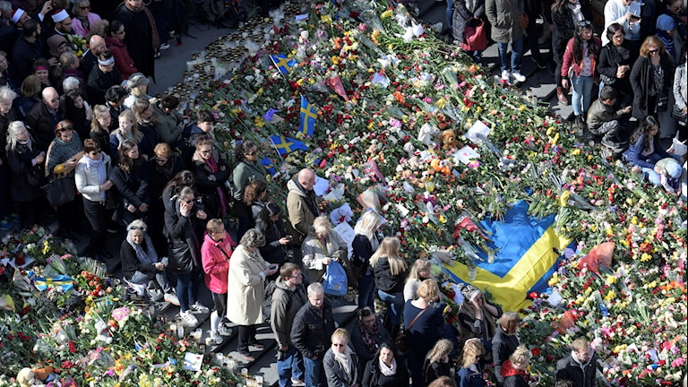 People gather in Stockholm in the days after the attack.