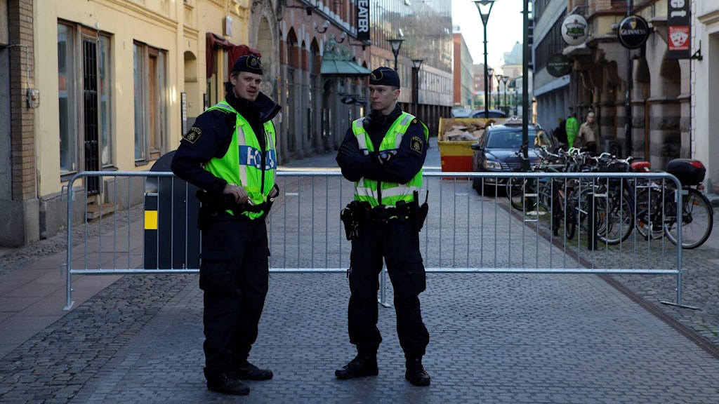 Police outside the court in Malmö, where the serial killer Peter Mangs was sentenced in 2012.