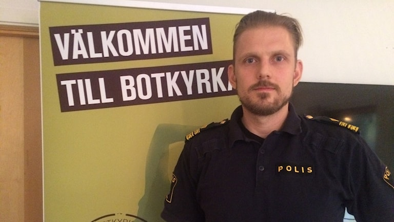 "Local police chief Erik Åkerlund in Botkyrka, southern Stockholm. ""Welcome to Botkyrka"" it says on the poster."