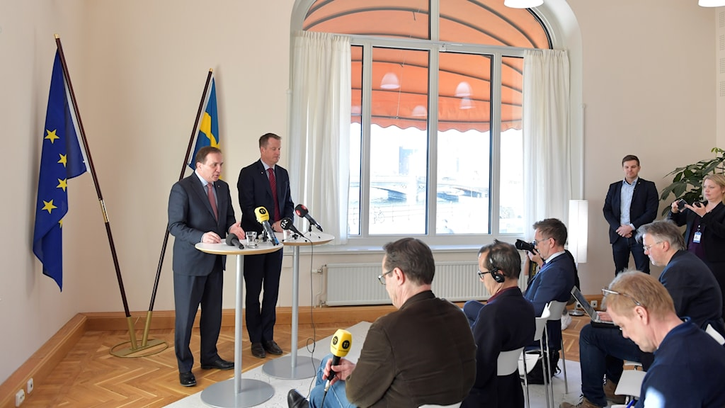 Sweden's prime minister and home affairs minister standing at lecterns for a press conference on Thursday