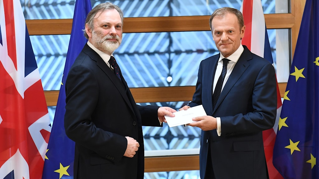 Britain's ambassador to the EU Tim Barrow (L) delivers British Prime Minister Theresa May's formal notice of the UK's intention to leave the bloc under Article 50
