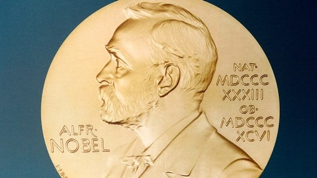 The gold Nobel medal.