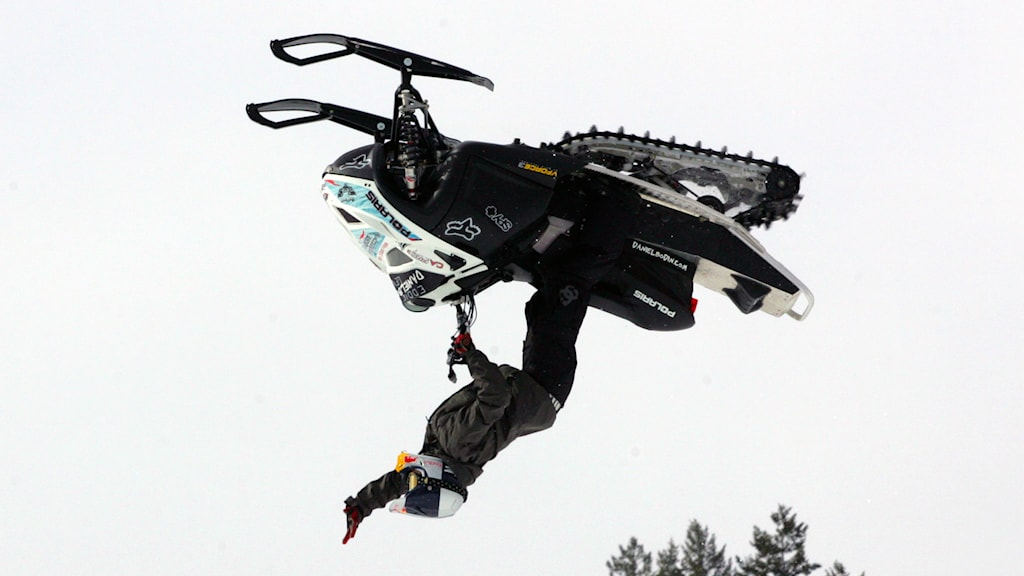 Daniel Bodin, of Sweden, flips up-side down with his snowmobile, Sunday, Jan., 27, 2008, during the Winter X Games at Buttermilk Ski Area near Aspen, Colo. (AP Photo/Nathan Bilow)