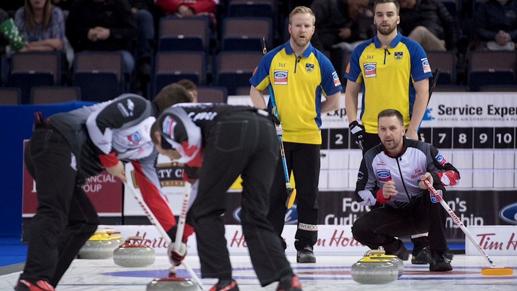 Canada skip Brad Gushue calls a shot as Sweden skip Niklas Edin and third, Oskar Eriksson, look on during the page 1-2 playoff at the men's world curling championships in Edmonton, Alberta, Friday, April 7, 2017. (Jonathan Hayward/The Canadian Press via AP)