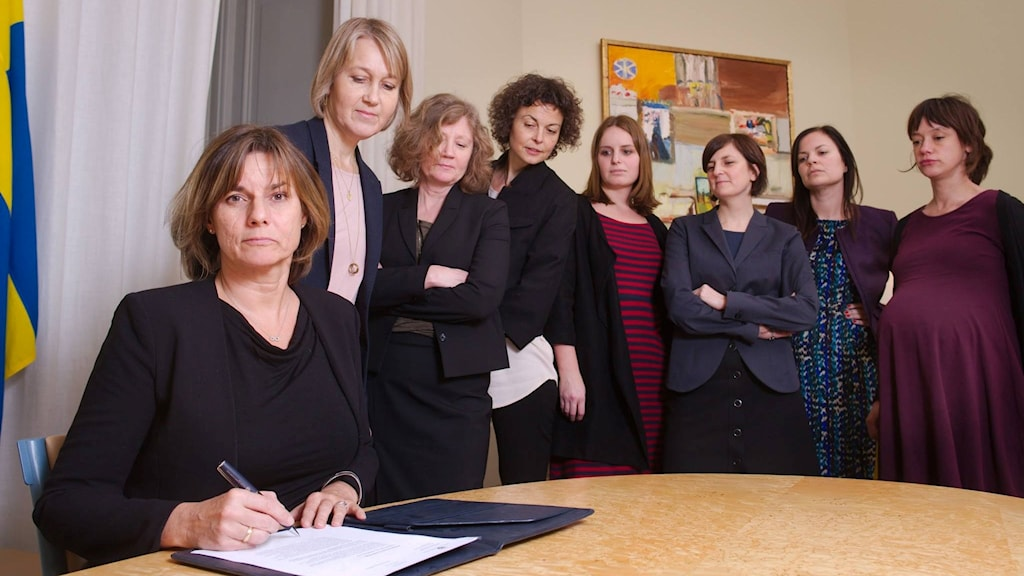 Sweden's deputy prime minister signs a bill.