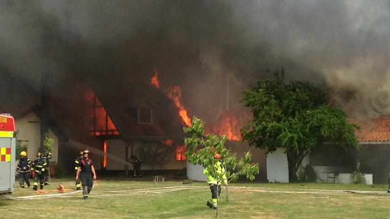Brand i ett hus