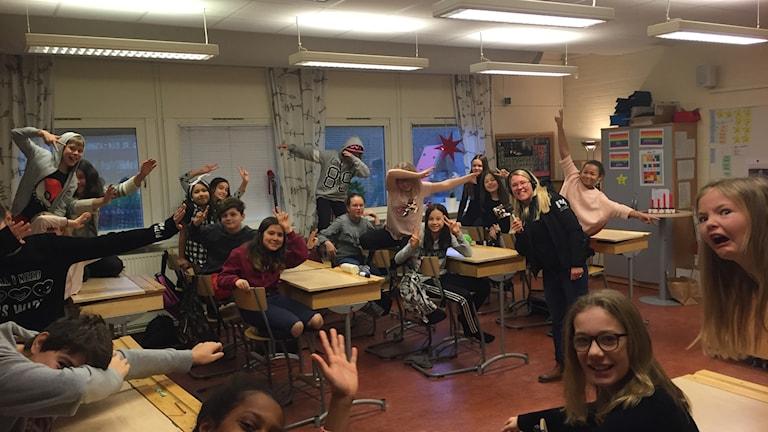 Skolklass i ett klassrum