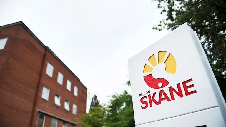 Sjukhus och logotyp.