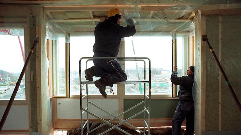 Två byggarbetare. Foto: Scanpix