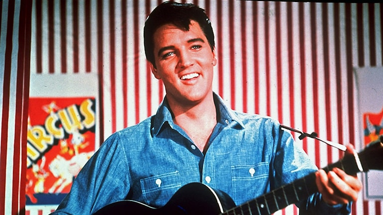 Elvis Presley is seen as a honky-tonk performer on the midway in this photo from the 1964 MGM film 'Roustabout'. The 'King of Rock 'n Roll' who died Aug. 16, 1977 would be turning 70 years old on Saturday Jan. 8, 2005. (AP Photo)