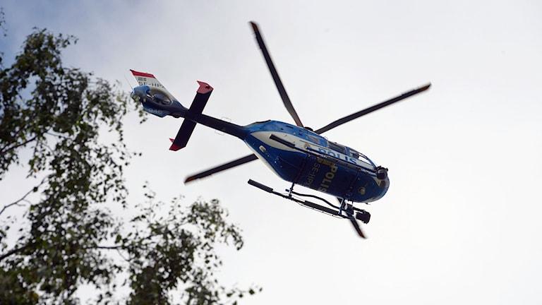 En polishelikopter på uppdrag. Foto: Johan Nilsson/TT.