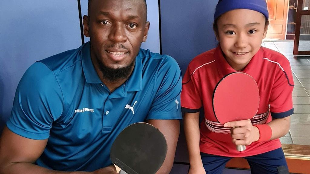 Bordtennisspelaren Laurynne Cabardo och världsstjärnan Usain Bolt.