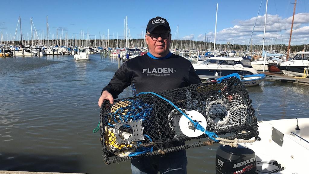 Robban Hellberg sportfiskare med hummertina