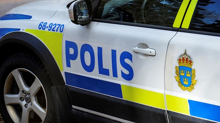 Bild på del av polisbil