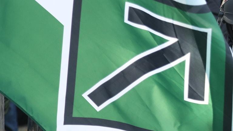 En del av nazistiska Nordiska motståndsrörelsens flagga