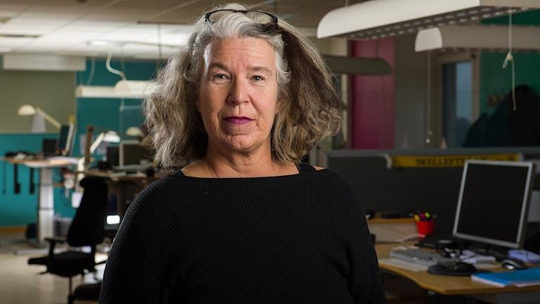 En porträttbild på Åsa Holst.