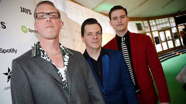 Tre av medlemmarna i Playtones. Foto: TT.