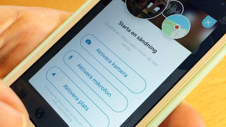 En mobiltelefon där appen Periscope är öppen.