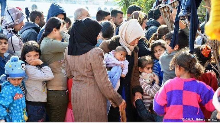 Flyktingar på gränsen mellan Grekland och Makedonien.