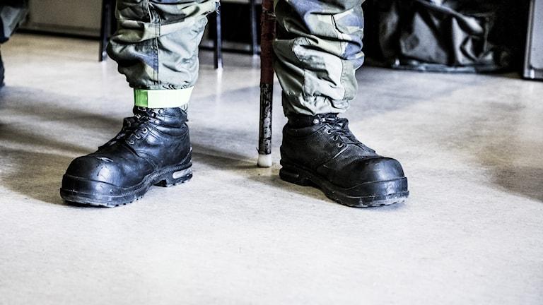 Kängor på en värnpliktig soldat.