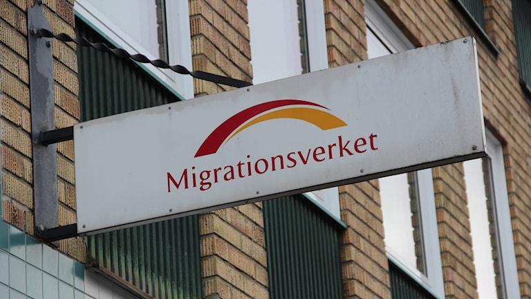 En bild på migrationsverkets logga.