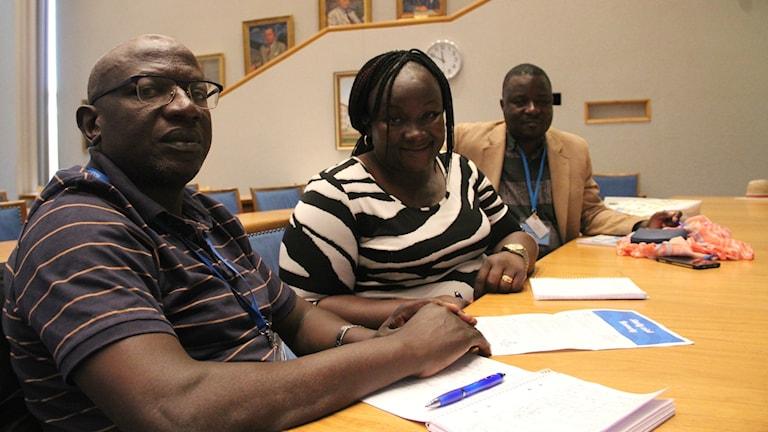 Daniel Christopher Kawesi, Gertrude Mpande Nansukusa  och Samuel Miiro från Nansana i Uganda.