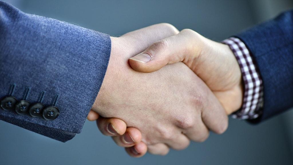 Ett handslag