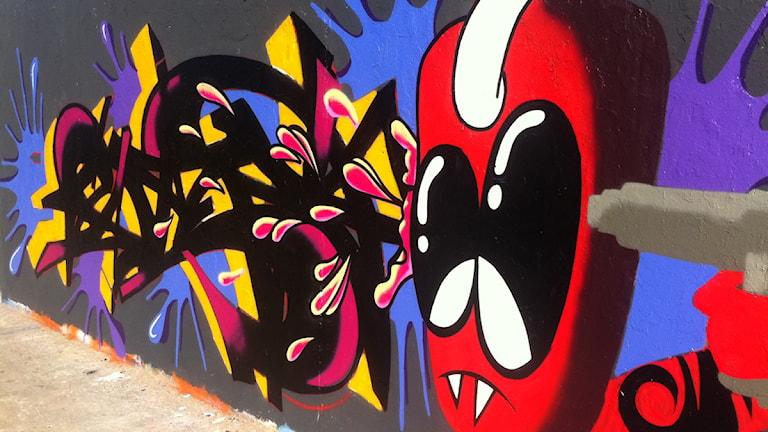 Exempel på laglig graffitimålning på Berlinmuren, Tyskland.