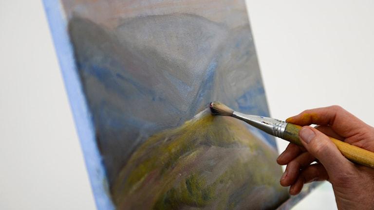 Person som målat en tavla.