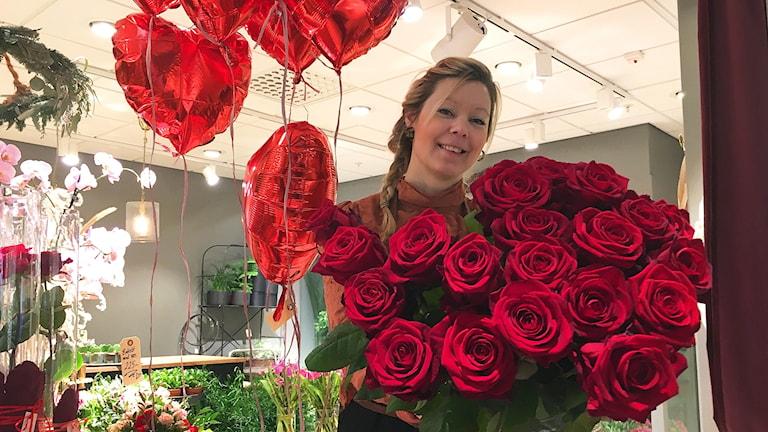 Martina Johansson i sin blomsterbutik i Växjö