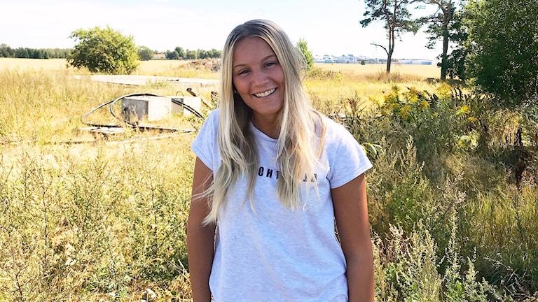 Sara Celebija från Ljungby är i bild och är glad.