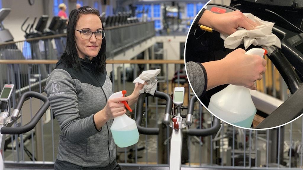 En kvinna står vid en träningscykel med en sprayflaska.