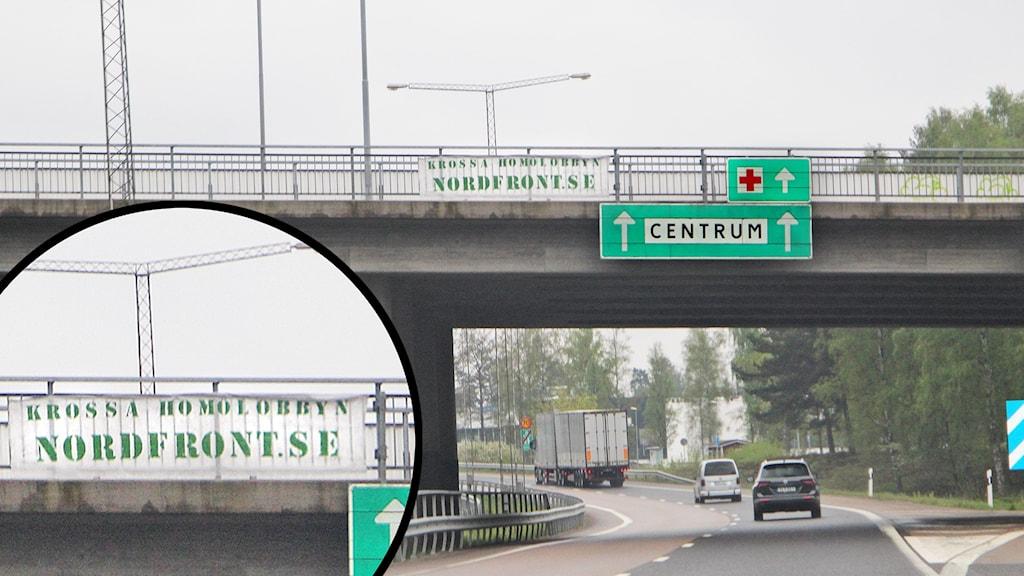 NMR banderoll hänger vid en bro över en väg