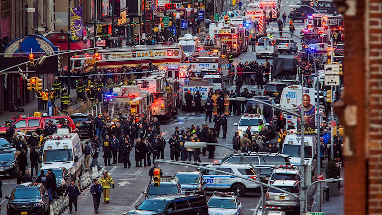 Law enforcement officials work following an explosion near New York's Times Square on Monday, Dec. 11, 2017