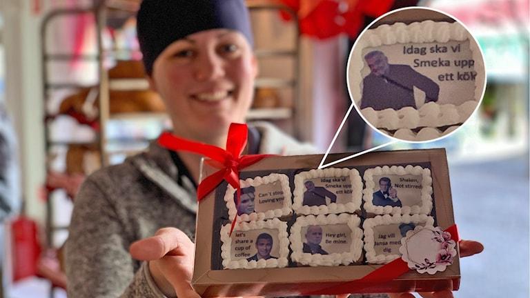 Konditorn Jennie Ström håller upp en ask med sex kakor i. På kakorna finns bilder på stiliga kända män med tillhörande citat eller text.