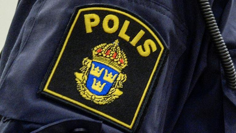 En bild på ett polisemblem
