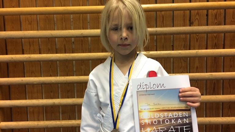Ture Runsten med sin medalj