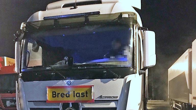 Lastbilschaufför i lastbil.